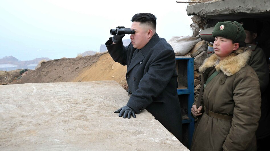 In this photo released in March by the North's Korean Central News Agency (KCNA), leader Kim Jong Un is said to be using a pair of binoculars to look south during an inspection of army troops stationed on two islands.