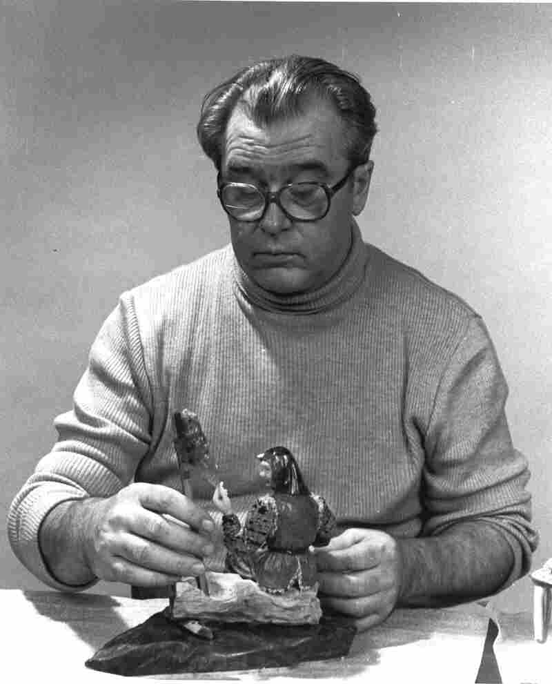Set designer turned sculptor Vasily Konovalenko (ca. 1984) is seen with a work titled Grandmother.