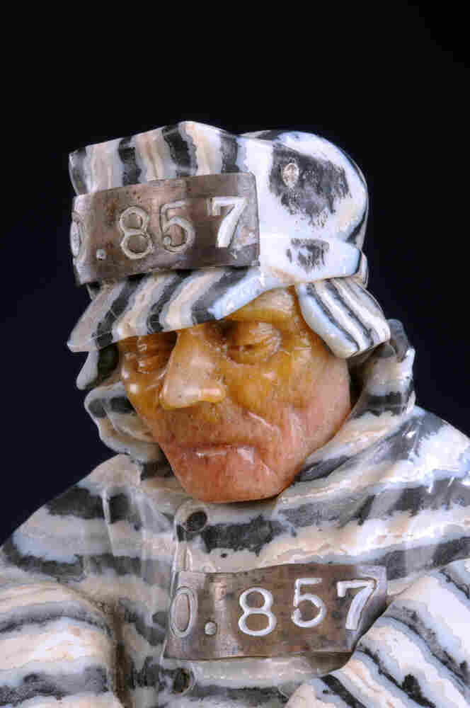 Prisoners was finished between the 1981 and 1984 period. Konovalenko manipulated banded obsidian to create the correct angles for the man's uniform. The sculptor also took advantage of the natural flaws in the Beloretsk quartz he used for the face; the man appears jaundiced, frostbitten and severely unhappy, as one might expect.