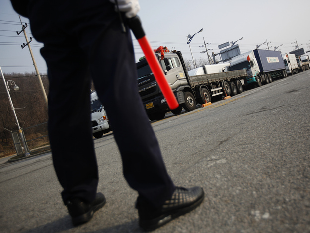 On Thursday, a South Korean security guard kept watch as South Korean trucks waited to enter the Kaesong industrial complex in North Korea. For the second day, the North blocked the trucks and workers from the South from entering its territory.