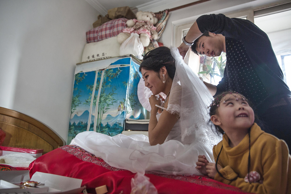 A scarcity of women in China is allowing them to make large financial demands of prospective grooms. In addition to money, grooms are expected to provide an apartment for their new wives.  (Sim Chi Yin for NPR)