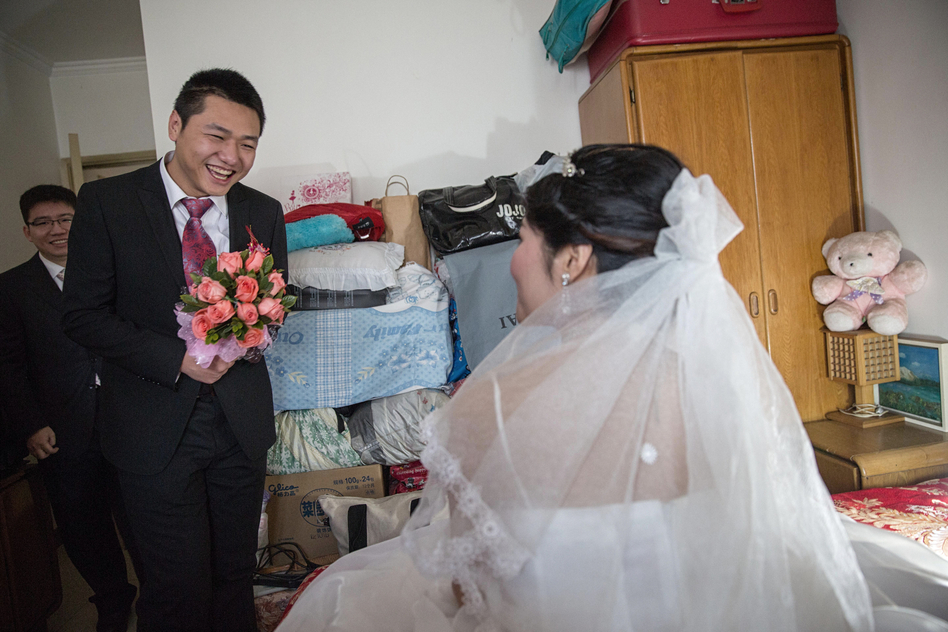 Wei finally makes it through the wedding games and finds his bride in her bedroom, waiting for him. (Sim Chi Yin for NPR)