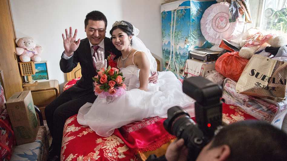 "Lucy Wang and Derek Wei represent the new modern Chinese bride and groom. With a lack of women in China, Wei had to pay more than $10,000 in a ""bride price"" to attract Wang to marry him. (Sim Chi Yin for NPR)"