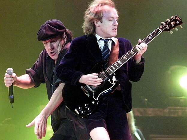 Brian Johnson (L) and Angus Young of AC/DC in 2000. Johnson's first album with the group, 1980's Back In Black, is one of the best-selling albums of all time, despite never reaching No. 1 on the Billboard album chart.