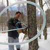 John Silloway fixes maple sap lines in Randolph, Vt., in February 2011.