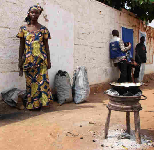 Kadidja Mamath sells hot porridge made of rice, sugar and milk on the roadside in the capital city, Bangui. The 19-year-old says the people of CAR have suffered enough and are ready for the coups to stop.