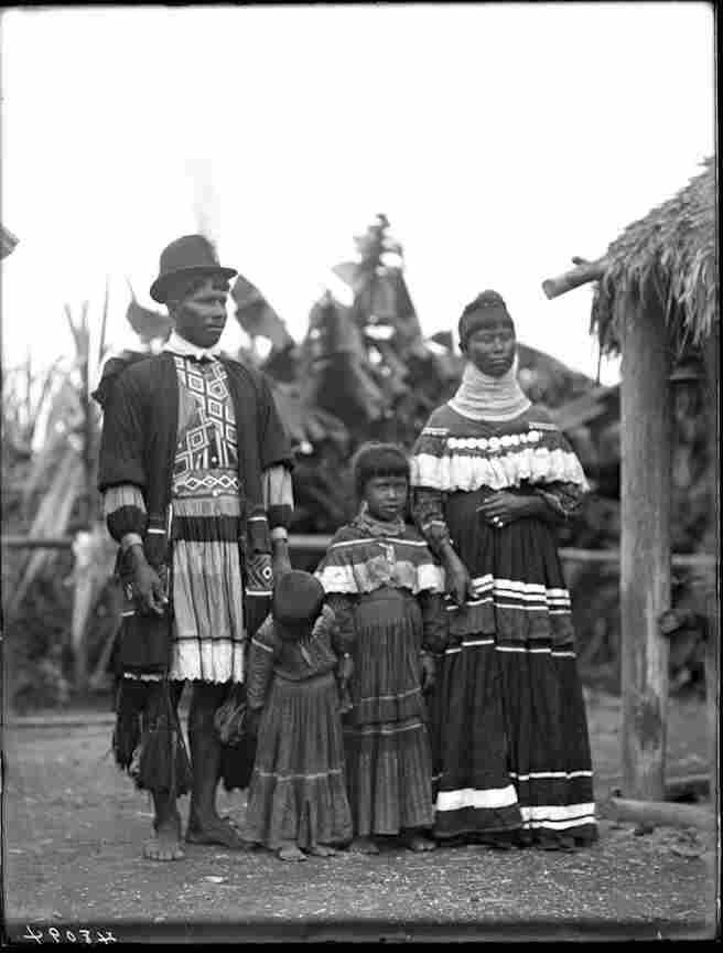 "A portrait of a Seminole family: Miami John Tiger with his wife Susie, daughter Annie ""Ruby"" Tiger, and another unidentified daughter."
