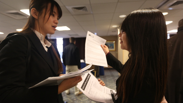 Li-Wen Hung (left) and Whitney Chen were waiting  to meet potential employers at a Manhattan job fair earlier this year. (Getty Images)