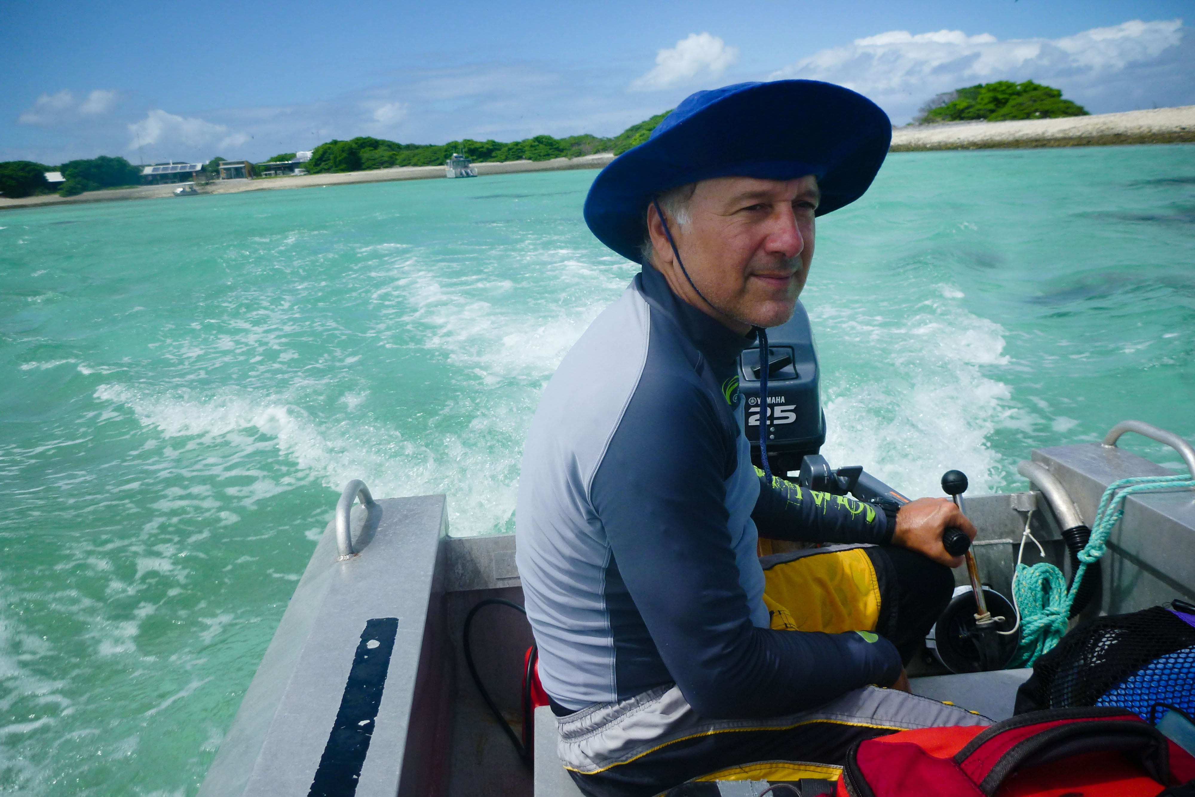Ken Caldeira, a researcher with the Carnegie Institution for Science, pilots an aluminum skiff filled with equipment for his experiment on the reef. He is trying to figure out whether corals would grow faster if he neutralized human-induced changes in the ocean's acid balance.