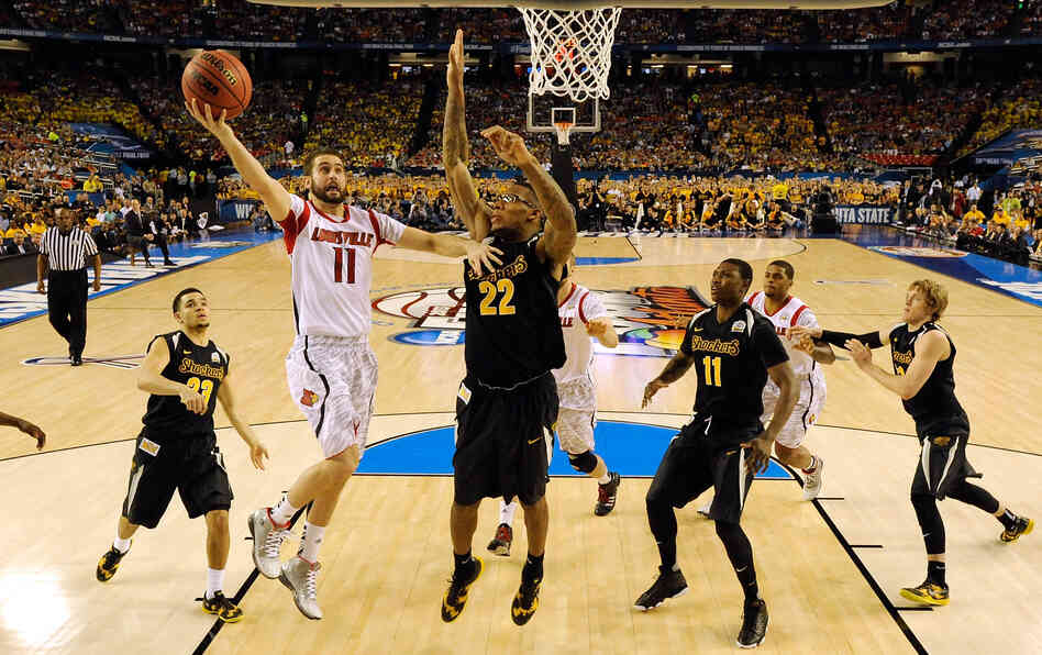 Luke Hancock, No. 11 of the Louisville Cardinals, drives for a shot attempt in the second half of the Final Four semifinal game against Wichita State Saturday.