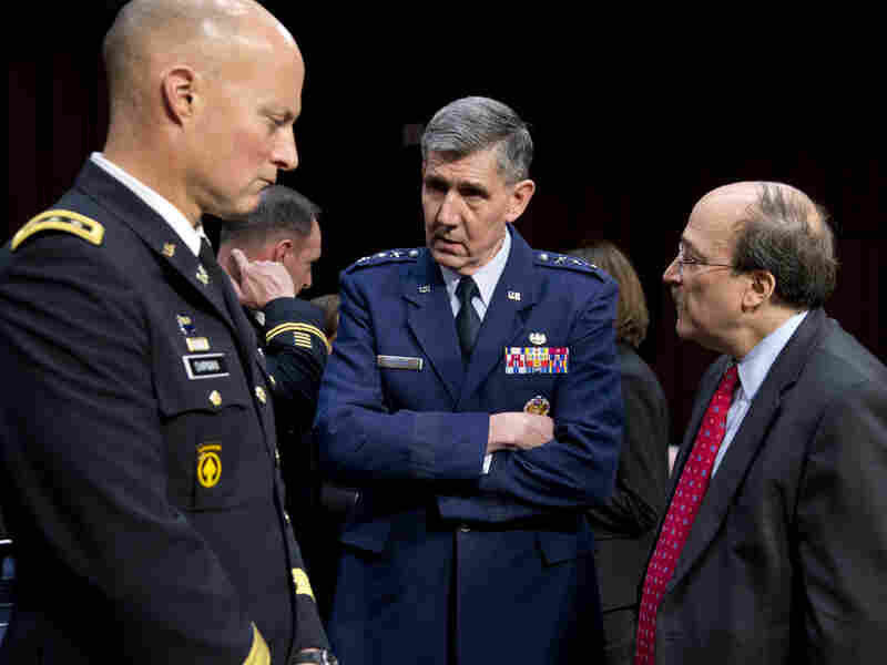 Lt. Gen. Richard Harding, Air Force judge advocate general, center, speaks with Army Lt. Gen. Dana Chipman, left, and Robert Taylor, acting general counsel of the Defense Department, prior to testifying before the Senate subcommittee on sexual assault on March 13.