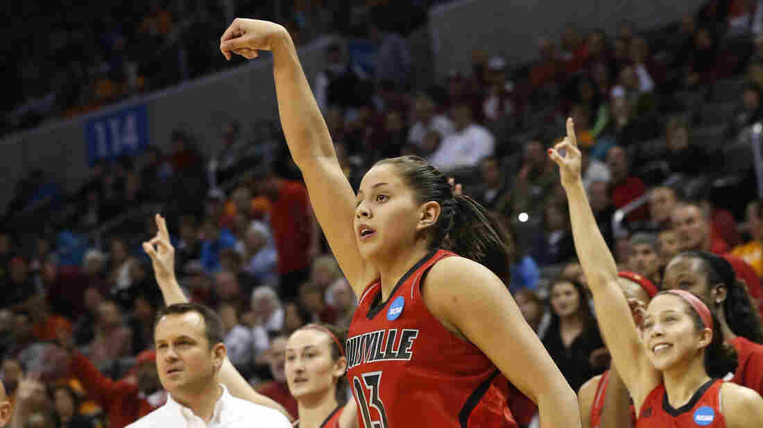 Louisville guard Shoni Schimmel (23) and the Louisville bench react to her 3-point shot against Tennessee in the second half of the regional final in the NCAA women's college basketball tournament in Oklahoma City on Tuesday. Louisville won 86-78.