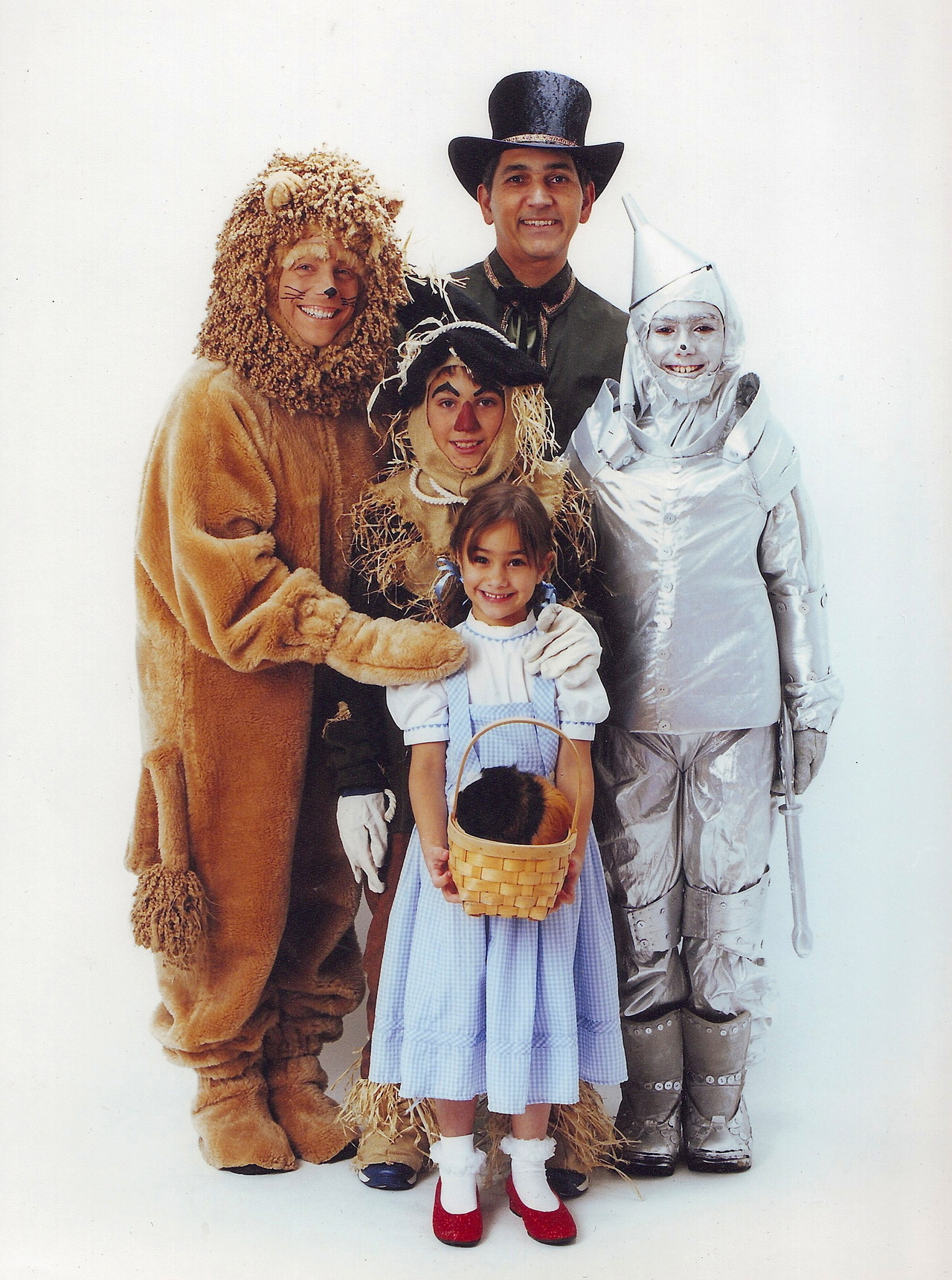 """The whole family dressed up one year for Halloween -- Dad was the Wizard, Mom was the Lion, oldest son was Tin Man, middle son was scarecrow, daughter was Dorothy, and guinea pig was Toto."" -- submitted by amberink"