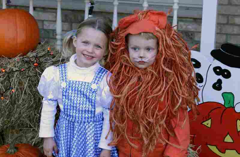 """My twins dressed up as Dorothy and the Lion one year. The Lion suit has now been passed down through three generations."" — submitted by barteleye"
