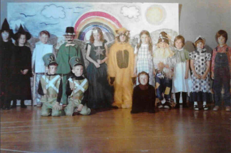 """This is a photo from 1977 when the 1st-grade class of Miss Franceschetti and the kindergarten class of Mrs. MacNabb took on the challenge of the FULL Wizard of Oz script and musical production. ... Recently the photo was shared on Facebook reconnecting the cast who shared their fond memories of being a part of"