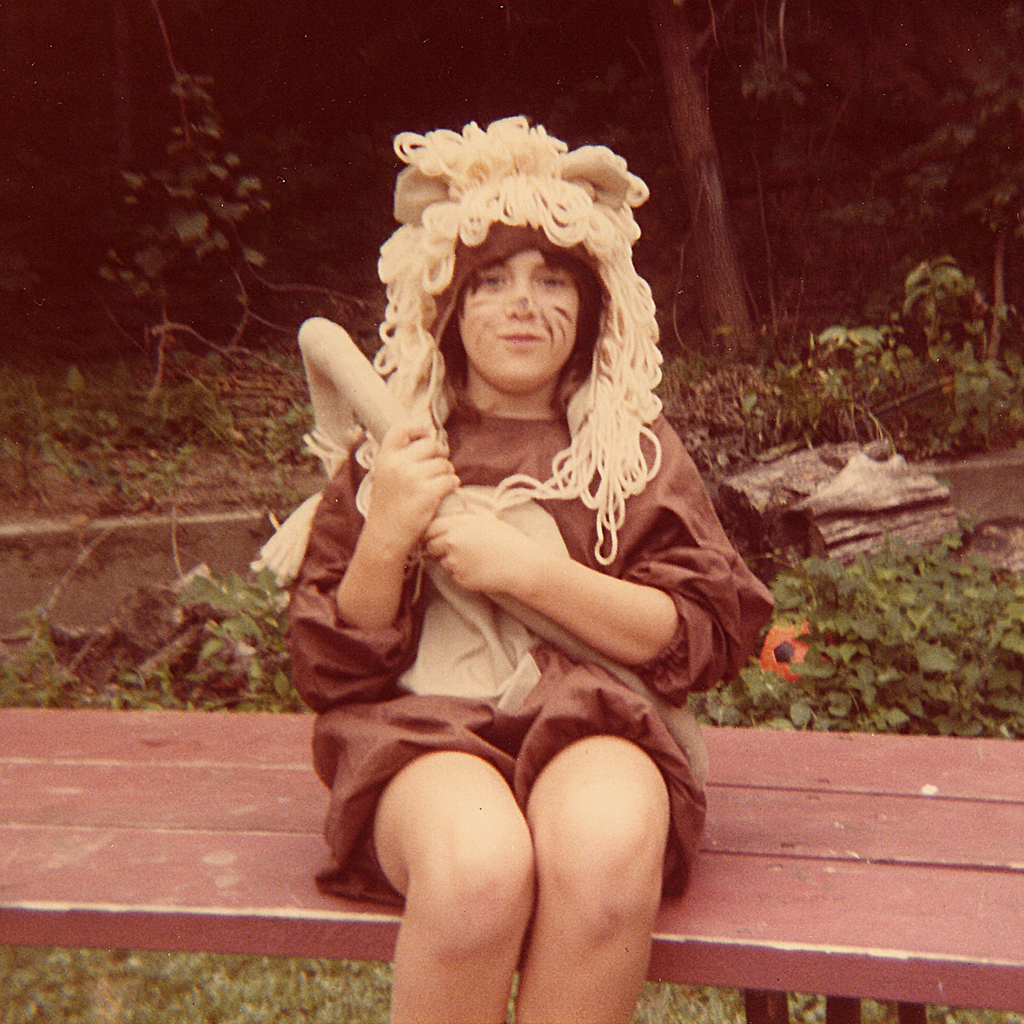 """My name is Jenny Barker Devine and I grew up in Council Bluffs, Iowa. We had the perfect back porch for staging productions. Over the years we did such classics as Lady and the Tramp and The Wizard of Oz. This is my sister, Karen Barker Crowley, as the Cowardly Lion, ca. 1985."" -- Jenny Barker Devine"