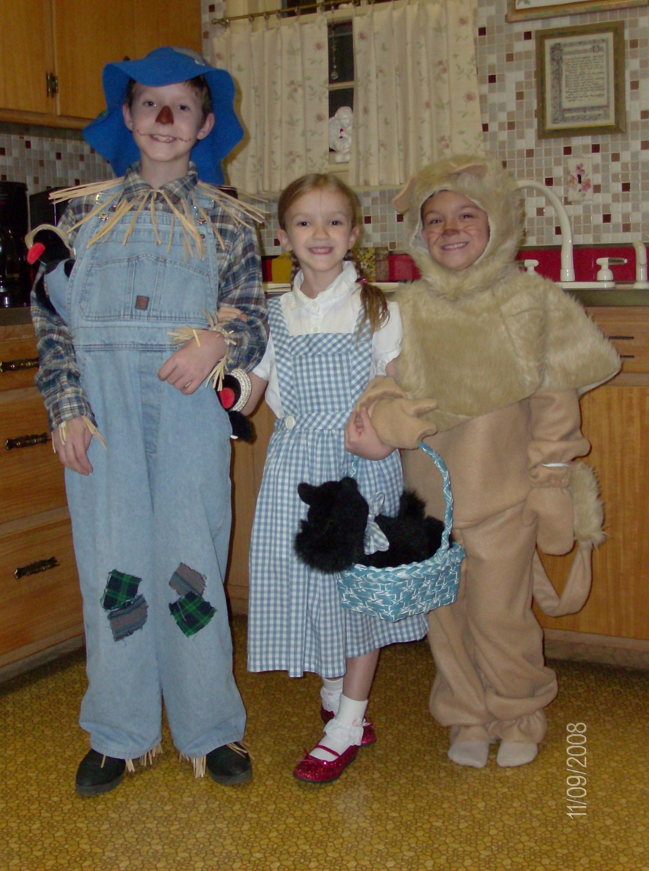 """2008: Mom made the Dorothy costume about 10 years earlier for older sister and made the Lion costume this year; Dad assembled the Scarecrow costume."" -- submitted by David W."