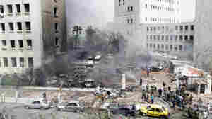 A deadly car bomb explosion rocked central Damascus, Syria, in front of the Finance Ministry building (center) and the Central Bank (right) on Monday.