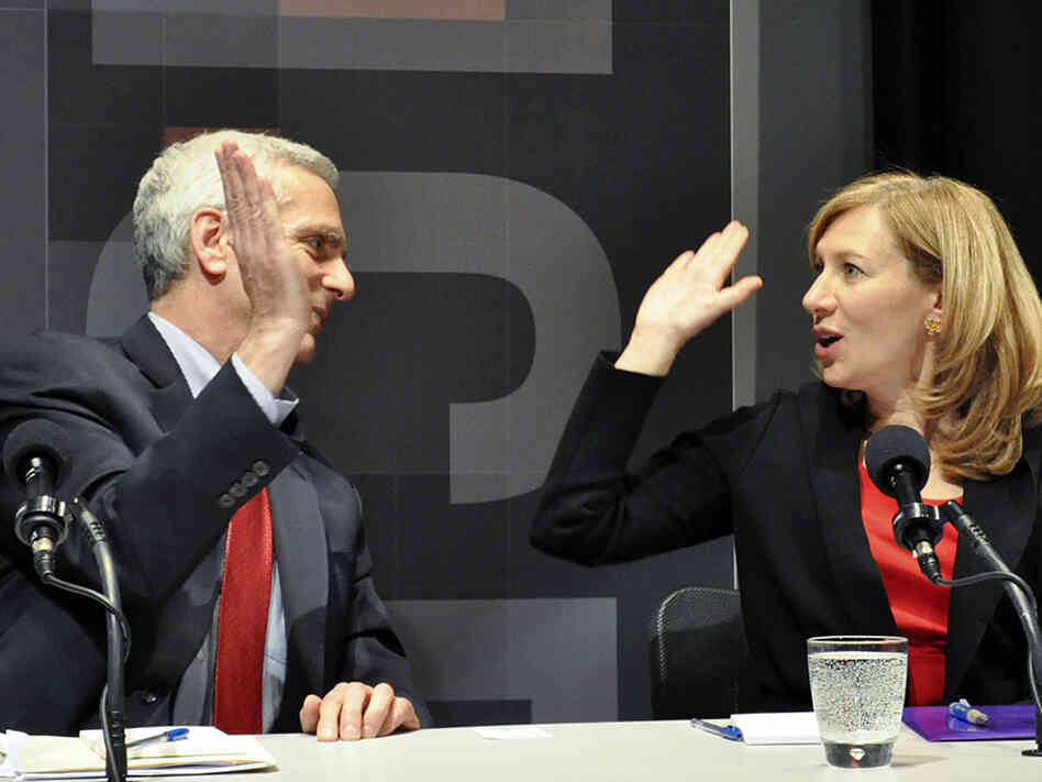 Jared Bernstein and Karen Kornbluh, who argued for keeping the minimum wage, celebrate their win in an Intellig