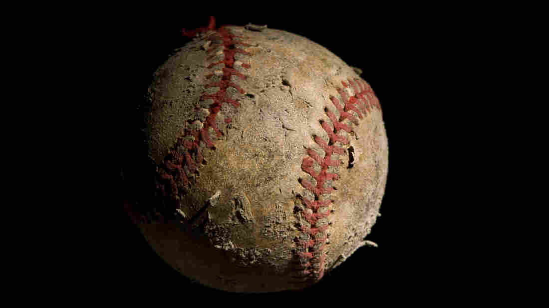 Closeup of an old, worn baseball