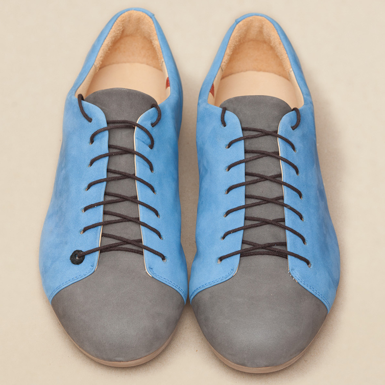 A pair of blue and gray shoes