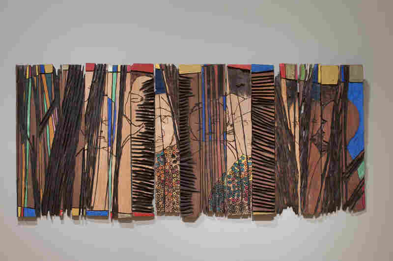 Anatsui's Conspirators (1997) is made up of individual strips of wood that can be arranged differently each time it's installed.