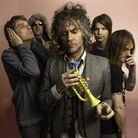 Wayne Coyne (center) with the rest of The Flaming Lips.