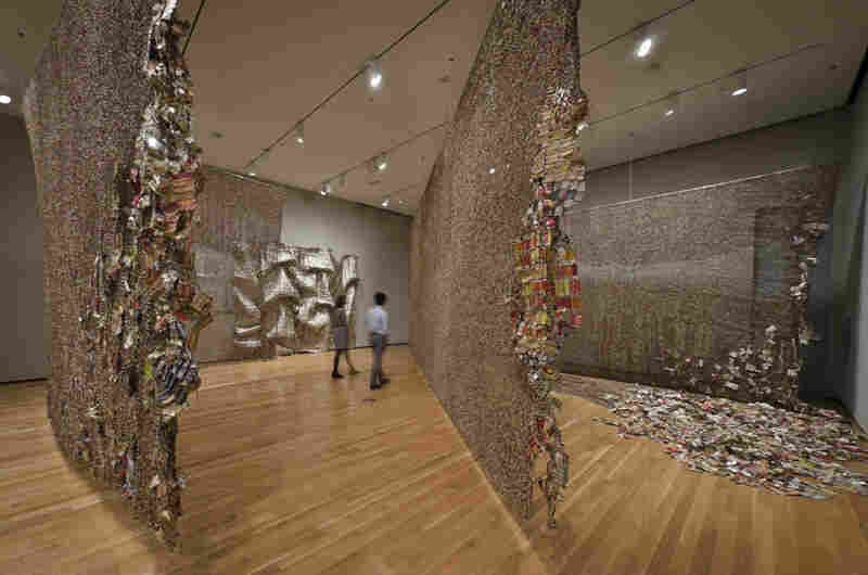 "Anatsui's Gli (2010) was inspired by the artist's visit to three cities – Berlin, Jerusalem and Notse, Togo — whose histories have been shaped by walls. In the Ewe language, which is spoken in Togo, ""gli"" can mean ""wall,"" ""disrupt"" or ""story."""