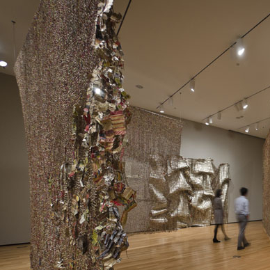 "Anatsui's Gli (2010) was inspired by the artist's visit to three cities - Berlin, Jerusalem and Notse, Togo -- whose histories have been shaped by walls. In the Ewe language, which is spoken in Togo, ""gli"" can mean ""wall,"" ""disrupt"" or ""story."""