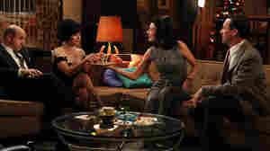 Dr. Arnold Rosen (Brian Markinson) and Sylvia Rosen (Linda Cardellini) celebrate New Year's Eve with Megan Draper (Jessica Pare) and Don Draper (Jon Hamm) as the sixth season of Mad Men opens.