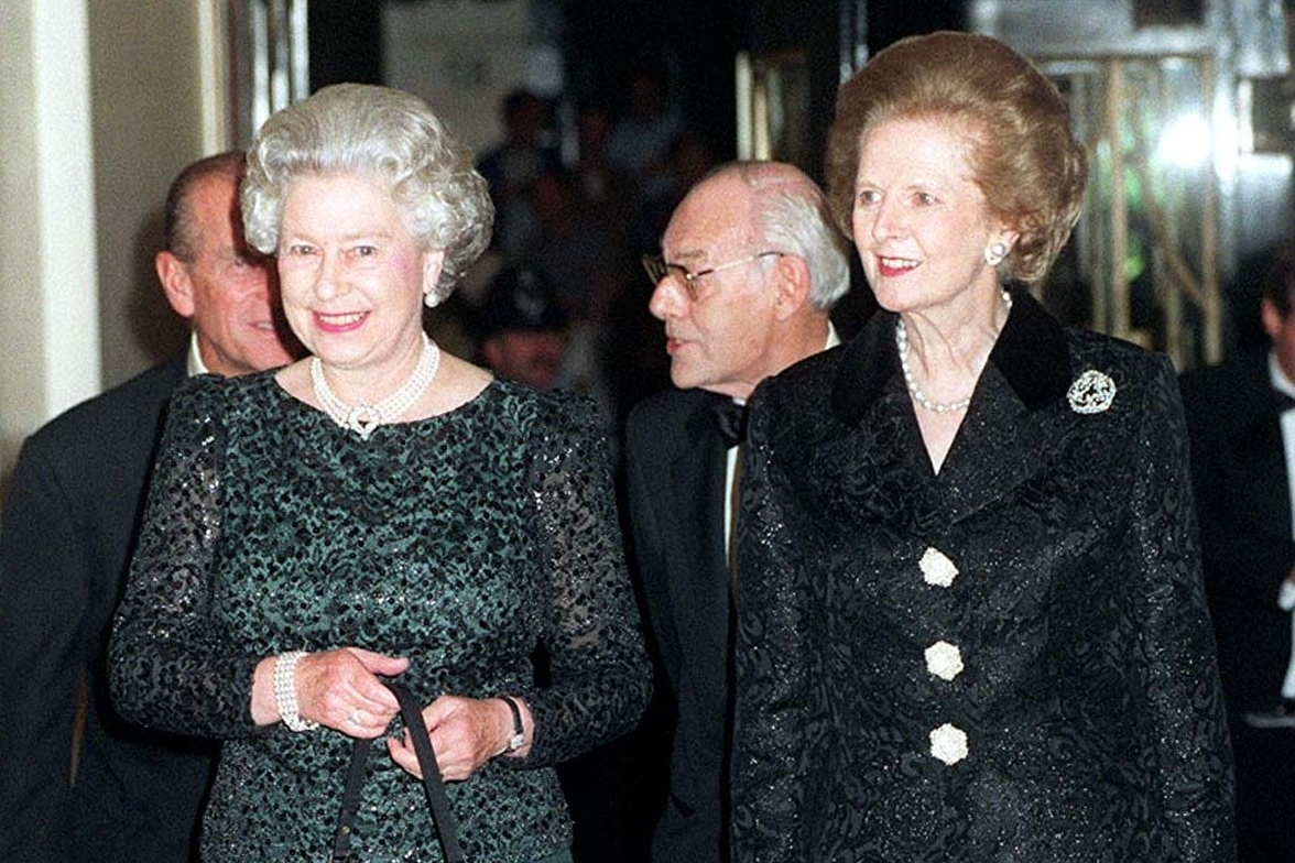 Britain's Queen Elizabeth II, left, and former British Prime Minister Thatcher arrive at Claridge's in London for a dinner to celebrate the former Prime Minister's 70th birthday on October 16, 1995.