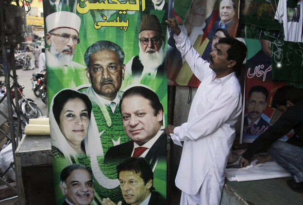 Pakistani vendors in Lahore fix posters of candidates taking part in the upcoming May parliamentary elections. Pakistani officials have provoked both laughter and criticism in recent days as they vetted potential candidates in the country's upcoming national elections with questions that veered between the controversial and the bizarre.