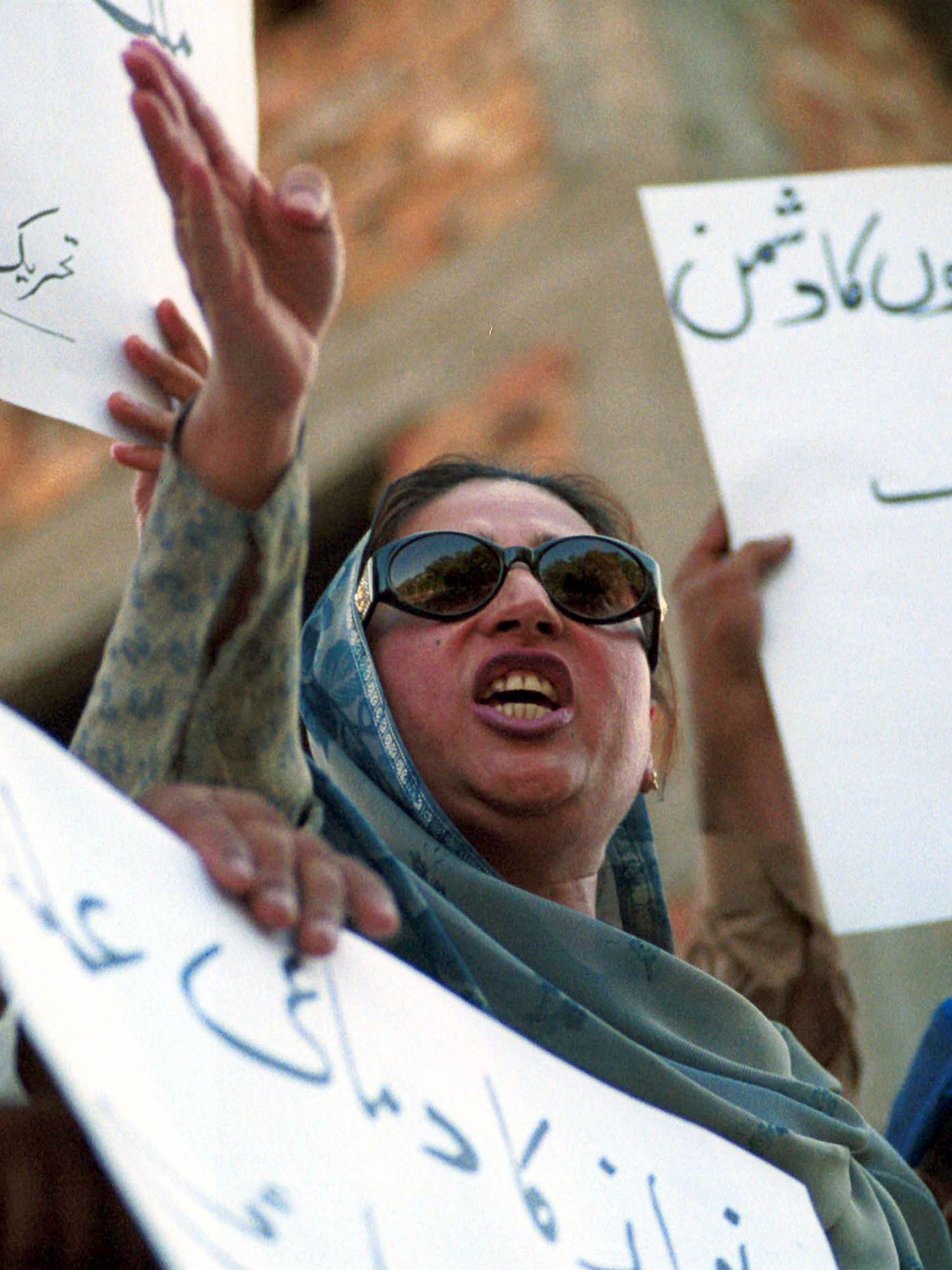 Mussarat Shaheen, Pakistan's dancer-actress turned politician, addresses her supporters in Islamabad in 2000. Better known for provocative moves than her piety, she recently rattled off a series of verses from the Quran when quizzed by an official.