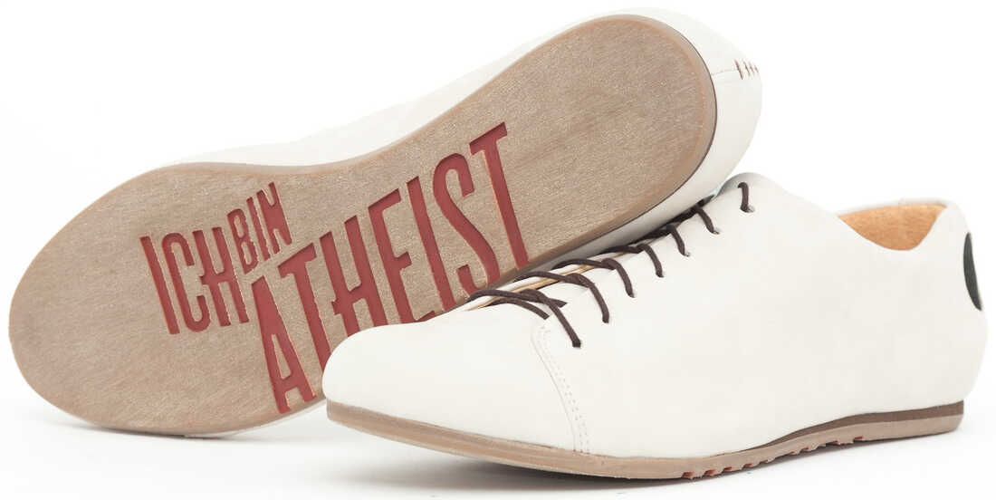 """White shoes with the writing """"ich bin atheist"""" on the sole"""
