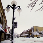 Main Street in Webster City, Iowa, has so far survived the 2011 closure of an Electrolux factory. But retraining funds and unemployment are running out for former workers, leaving businesses worried that a serious downturn is ahead.