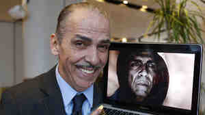 Moroccan actor Mehdi Ouazzani with an image of himself in character as Satan.