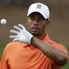 Tiger Woods spends some time on the driving range during Monday's practice round for the Masters golf tournament in Augusta, Ga.