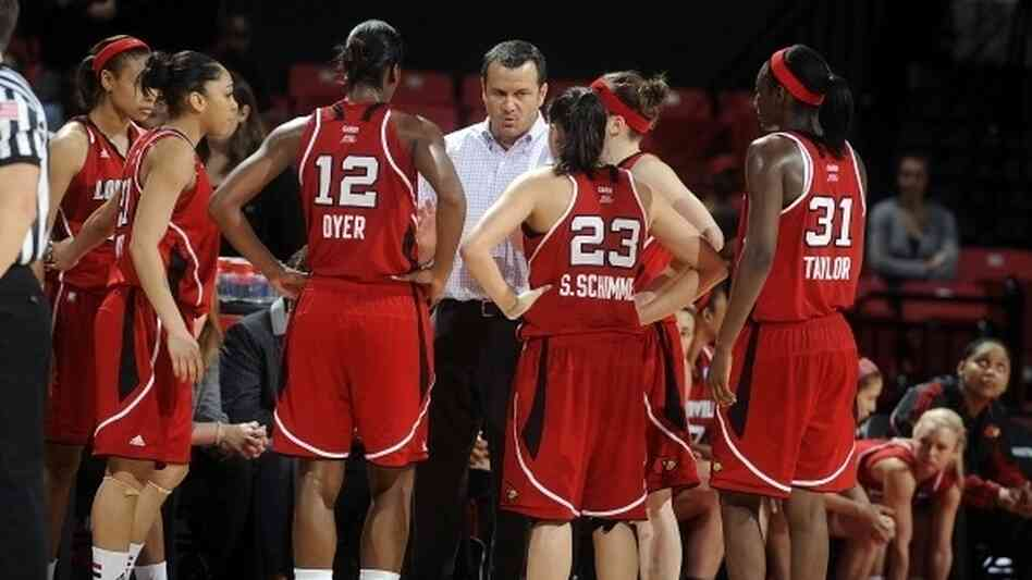 Head coach Jeff Walz of the Louisville Cardinals talks to his team during a timeout in the game against the Maryland Terrapins in the second round of t
