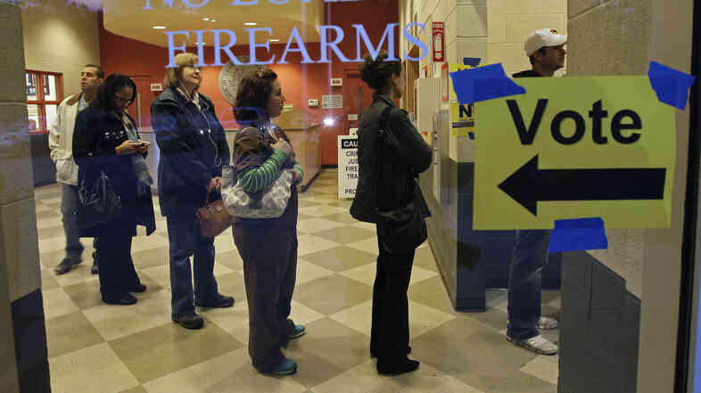 People stood in line to vote on Election Day 2012 at the Wake County Firearms Education and Training Center in Ape