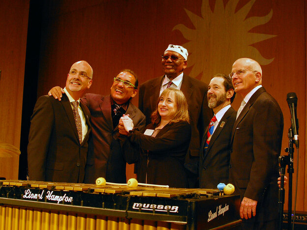"A group of musicians and major donors pose with Lionel Hampton's vibraphone at the 2013 Jazz Appreciation Month launch. From left: Mark Dibner of The Argus Fund, drummer Horacio ""El Negro"" Hernandez, Fran Morris Rosman of the Ella Fitzgerald Charitable Foundation, pianist Randy Weston, Richard Rosman of the Ella Fitzgerald foundation and Smithsonian American History Museum Director John Gray."
