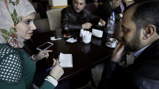 Razan Shalab Al-Sham, 26, is from a wealthy Syrian family and has been working to bring supplies into the country for the Syrian Emergency Task Force. Here she meets with local councils in Syria who came to the southern Turkish city of Gaziantep.