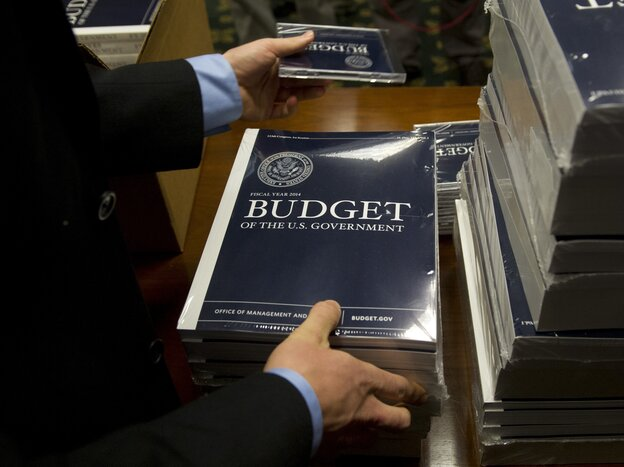 Senate Budget Committee staffers unpack boxes of President Obama's 2014 budget proposal on Wednesday.
