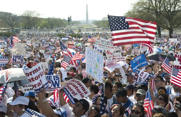 """Thousands of immigration reform supporters march in the """"Rally for Citizenship"""" at the Capitol in Washington, D.C., on Wednesday."""