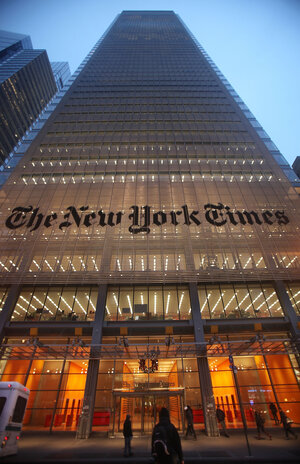 The New York Times sign is displayed in front of the newspaper's midtown headquarters in New York City.