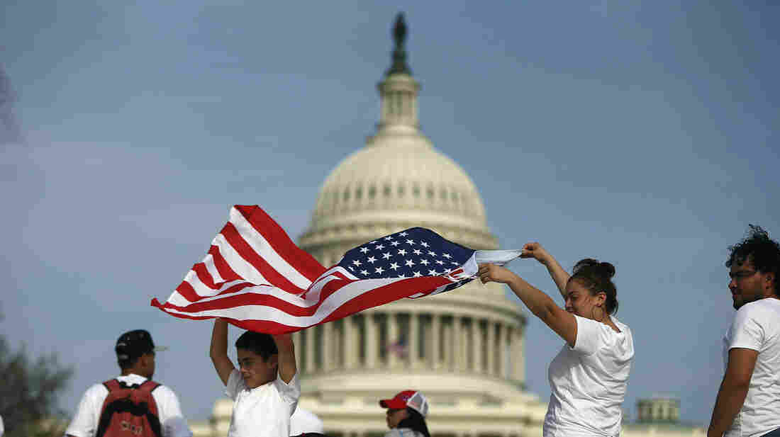 Jissela Centeno and son, Matthew Pineda, hold an American flag at a rally for immigration reform at the U.S. Capitol on Wednesday.