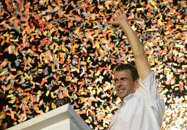 Venezuelan opposition presidential candidate Henrique Capriles waves to supporters during