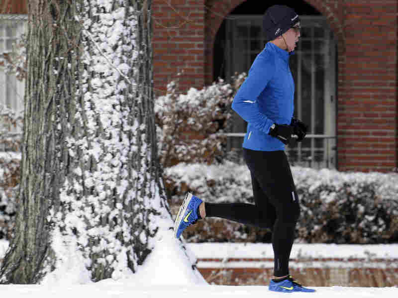A Denver man runs in the snow near Washington Park after a winter storm moved through town in late January.