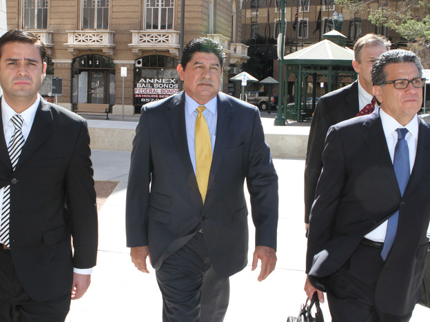 Former El Paso Independent School District Superintendent Lorenzo Garcia is escorted by his attorneys into a Texas courthouse. He was found guilty of fiddling with El Paso schools' test scores for his own financial gain.