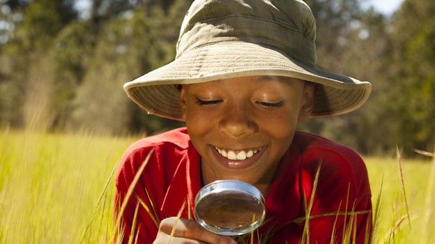 Boy with magnifying glass (iStockphoto.com)