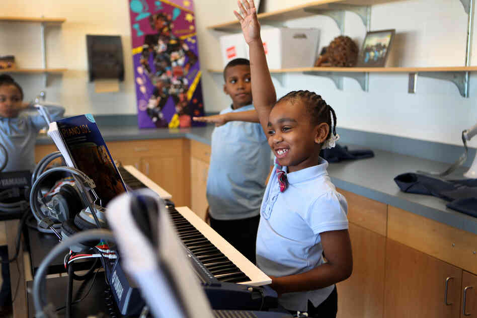 Third-grader Jionni Anderson is learning to play keyboard at Savoy Elementary School in Washington, D.C.